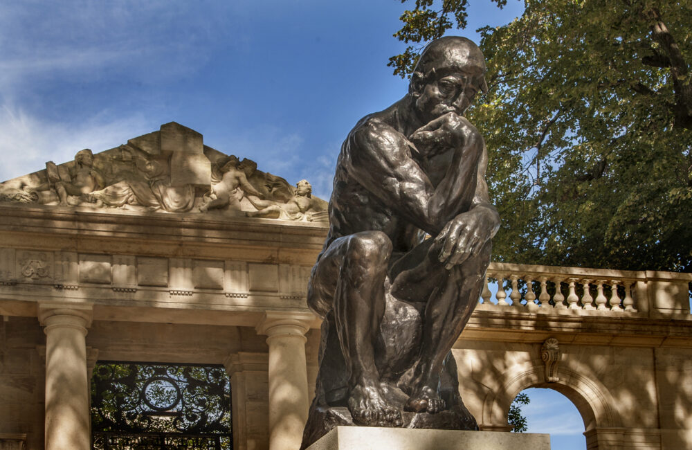 """Rodin's """"The Thinker"""" muses at the gateway to the Rodin Museum on the Benjamin Franklin Parkway in Philadelphia. One of the city's museum gems, this elegant structure houses the largest collection of work by Auguste Rodin outside of his native France."""